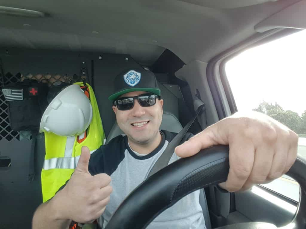 Marco Silva, Owner, in his locksmith van on his way to a job.